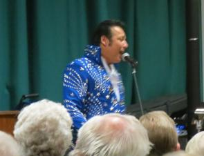 \\\\'Elvis\\\\' performing a number infrony of the microphone