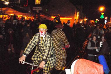 Christmas Fayre - Clowning around on their strange bike