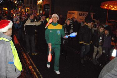 Christmas Fayre - Juggling illuminated clubs light the way
