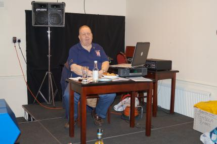 Quiz master Iain takes centre stage