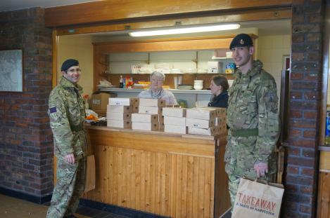 The ladies at the counter giving lunch to the Royal Fusileers generously donated by the local Harvister Restaurant