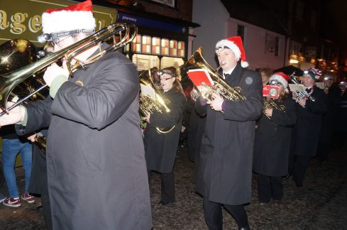 The brass band leads the way