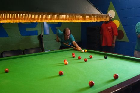 Contestants playin in the snooker room