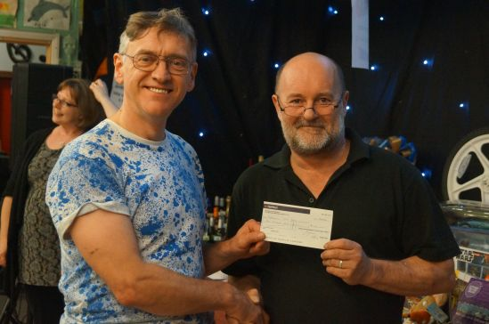 Lion President Phil (left) presents cheque to Joe for the Youth Club