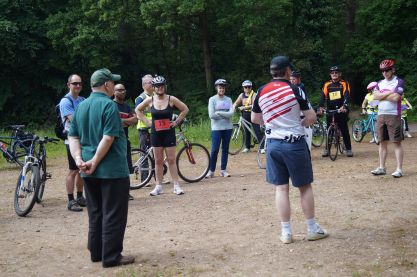 John gives instructions to the cyclists